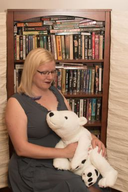 Crystal hugging Major Ursa, the stuffed polar bear.